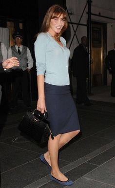 Fitted sweater and pencil skirt with flats.