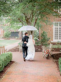 A romantic rainy wedding photo | Brides.com