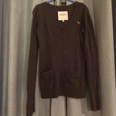 Abercrombie sweat shirt! Brown Abercrombie sweater with pocket details on the front. Is as comfy as it looks :) Abercrombie & Fitch Sweaters