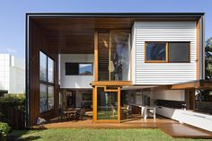 Contemporary extension on weatherboard house by Tim Stewart Architects
