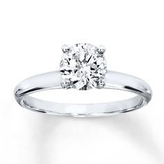 A stunning round diamond is the centerpiece of this elegant engagement ring. Crafted of white gold, the ring has a diamond weight of 1 carat. Diamond Total Carat Weight may range from - carats. Elegant Engagement Rings, Wedding Rings Solitaire, White Gold Wedding Rings, Bridal Rings, Solitaire Engagement, White Gold Rings, Purple Wedding, 1 Carat Diamond Ring, Tiffany Wedding Rings