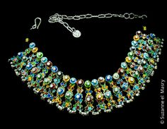 Large silver necklace with cloisonné enamel and tassels. By: Suzanne El Masry