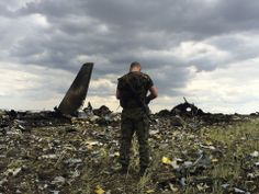 Death of a giant. A pro-Russian fighter guards the site of remnants of a downed Ukrainian Air Force Il-76 at the airport near Luhansk, Ukraine. Pro-Russian separatists shot down the military transport plane Saturday, killing all 49 service personnel on board, Ukrainian officials said.  Evgeniy Maloletka, AP