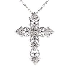 @Overstock - Boasting elaborate filigree, elegant metalwork, and dazzling white diamonds, these polished diamond cross necklaces are one of a kind. With a rhodium finish, 20 crystal clear diamonds and wrought silver, this is bound to look great and impress.http://www.overstock.com/Jewelry-Watches/Sterling-Silver-1-4ct-TDW-Diamond-Cross-Necklace/5137221/product.html?CID=214117 $47.99