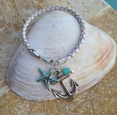 White Genuine Bolo Leather Bracelet with silver anchor and Turquoise star fish and bead.