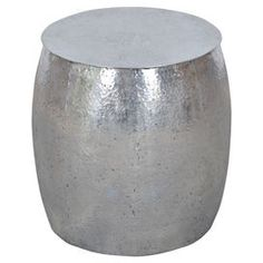 """Crafted from tempered metal, this drum-shaped side table brings hammered detail to your living room or study.  Product: Side tableConstruction Material: MetalColor: SilverDimensions: 18"""" H x 18"""" Diameter"""