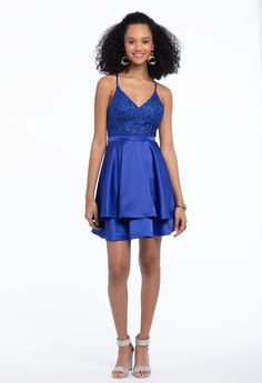 Don't be shy: be bold en blue with a vivid party dress! Featuring a V-neck, fitted lace bodice, tiered A-line skirt and racer back, this satin short cocktail dress is a favorite for sweet 16 parties, spring flings and everything in between! Accessorize with rhinestone heels and an adorable satin bow clutch.