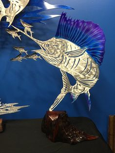 Sailfish Bust - Standing Mount - Powdercoat  This Sculpture has a Candy Blue, Purple, Black & Transparent Clear Powdercoat.  Using only the best local hardwoods found in South Florida. We hand craft & carve each base. First, we chainsaw, hand sand, polish and apply several coats of polyurethane to create a stunning standing mount or tournament trophy.  https://themetaledge.com/trophies/sailfish-bust-standing-mount-powdercoat.html