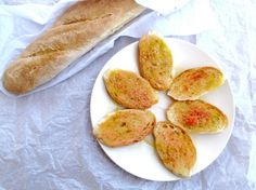Pan Catalan. Grilled or toasted baguette rubbed with fresh tomato and garlic, and drizzled with olive oil and a sprinkling of salt. (An easy appetizer, and the tastiest of Spanish tapas.)