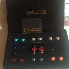 Rare Joan Rivers Interchangeable Earrings Used in original box with paperwork Rare Joan Rivers Classic Collection of 10 interchangeable colored hearts. They fit in a gold setting & are magnetized on the back. Pops out easily with a pin (I'll include 1). Gorgeous collection. I just have too much jewelry & don't find myself wearing as much as it deserves. No trades Joan Rivers Jewelry Earrings