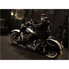 """Stan Ellsworth of """"American Ride"""" with the Harley on the set."""