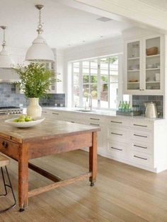 Modern farmhouse inspired residence + white kitchen cabinets with vintage wood k. Modern farmhouse inspired residence + white kitchen cabinets with vintage wood kitchen island and blue backsplash Home Decor Kitchen, Kitchen Interior, New Kitchen, Kitchen Dining, Kitchen Ideas, Kitchen Wood, Awesome Kitchen, Kitchen Layout, Kitchen Hacks
