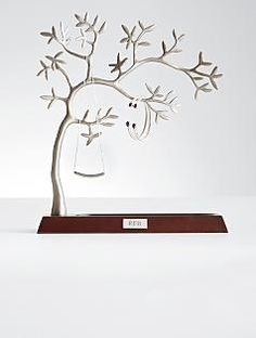 sculpted jewelry tree = I got one very similar to this at Target...put all my favorite earrings on it.  It looks pretty on my dresser and my earrings are easy to find!