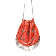 "A ladies evening bag of coral silk velvet with a drawstring chain and steel cut beaded accents. This was the height of fashion in 1910!Bag measures 6.5"" X 7.5"". Including draw string chain, the overall height is 13.5"""