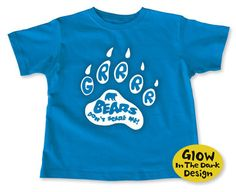 Grrr...Bears Don't Scare Me! has a glow-in-the-dark design and is printed on a soft, cobalt blue t-shirt. $15.95