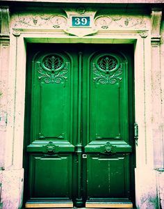 Photograph of a rustic, emerald green door in the Latin Quarter, Paris, France. Original Fine Art Photography by Tracey Capone.