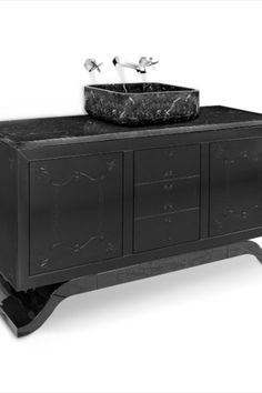 Inspired in The Metropolitan Museum of Art, the METROPOLITAN washbasin resembles a central mausoleum structure, blending the contemporary chic urban attitude with the classic sober lines. The wooden structure and feet are black lacquered with a high gloss black varnish, featuring a carefully handcrafted carving detail on the glass doors. It has a countertop and rectangular sink made of Nero Marquina marble, making this piece extremely elegant and luxurious.