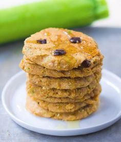 A giant stack of extra fluffy zucchini pancakes, with melty gooey chocolate chips - These are guaranteed to disappear quickly!