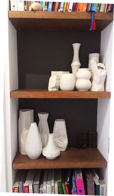 black painted backdrop to oak shelves  with collection of vintage German retro porcelain vase