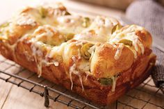 Shredded pepper Jack cheese and pickled jalapeño nacho slices are layered between pieces of refrigerated biscuits to make this flavorful monkey bread.