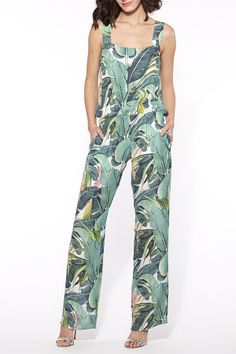 Just Cavalli is bringing the palm trees to you with this amazing jumpsuit!