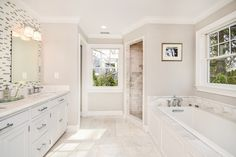"""Sherwin Williams """"crushed Ice"""" paint color! hmmm…...Transitional Master Bathroom with MS International Calacatta Gold 2x4 Polished Marble, Inset cabinets, Flat panel cabinets"""