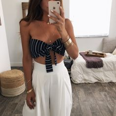 Multi tie bandeau crop top. Love! Tie in the front as bow or around neck. Model is wearing Small. Zipper closure. No Stretch. shop the MATCHING SHORTS or CHLOE TROUSERS