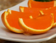 Orange jello inside of an orange peel... I'm trying to find a champagne jello recipe to put inside for the ultimate mimosa jello shot on new years!