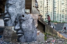 "In Shanghai the street artist known as JR has pasted massive portraits of elderly Chinese men and women on the sides of water towers and decrepit buildings. His ""point"" is that China is changing and modernizing so rapidly that it's dizzying.  And soon even traces of the old buildings – and the elderly people who used to live in them – will disappear. At Juxtapoz, the writer said,  ""It can be difficult to look back and honor your past when your future looks so bright.""  Seems about right…"