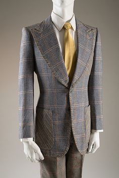 Tommy Nutter suit   England, 1969   Glen plaid wool   'Tommy brought innovation and creativity to the classic culture of Savile Row tailoring', says his friend, Peter Brown. 'We opened his shop in 1968.  It was not legal to be gay in England until 1968, but young people then didn't care -it was really rather cool to be gay'   A Queer History of Fashion (September 2013-January 2014)   The Museum at FIT, New York