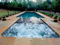 spa incorporated into pool. sun pod water feature. cascade pools.