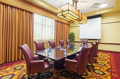 Our Executive Boardroom at the Courtyard by Marriott La Vista seats 10 comfortably, has a drop down screen and is the perfect size for your next small meeting.
