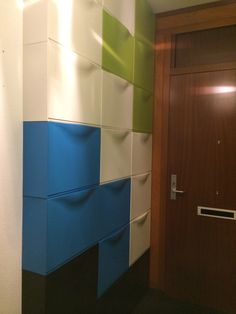 Tetris wall in the hallway.  We indulged our inner geeks by using Ikea Trones shoe cabinets in 3 different colors to construct floor to ceiling storage space with a Nintendo Tetris theme. Falling and stacking blocks make our hallway so much more fun.