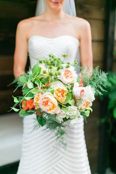lush bouquet with greenery, photo by Troy Grover Photographers http://ruffledblog.com/colorful-wedding-at-hotel-ballard #weddingbouquet #flowers