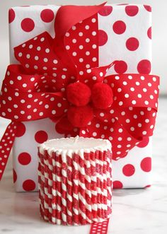 Pictures of dots | Via Dorian Ortowski!!! Bebe'!!! Love red and white contrasting polka dots on paper and ribbon and bow with red pompoms as a trim is striking!!!