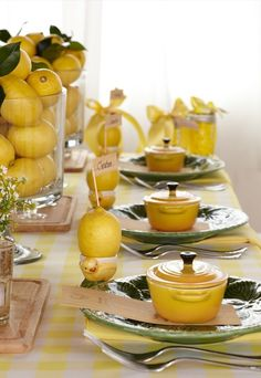 Lemon decorated table - I can do this with limes & my little apple green Le Creuset pots from Jacque !