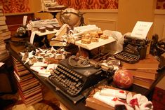Stacks of books supported and decorated the dessert tables. Typewriters, globes, and open books added to the presentation.