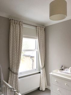 Beautiful nursery curtains And nursery Roman Blind complete with pompom, hand made by Rascal & Roses using wonderful Flohr & Co linens- dove grey dotty for blind and bunnies with dove grey dots for the curtains.