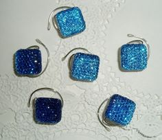 These #hairswirls come in lots of colors.  Click on the #Etsy icon tto see more.  6 Hair Swirls in Dazzling Bright Aqua Squares  by hairswirls1, $11.99