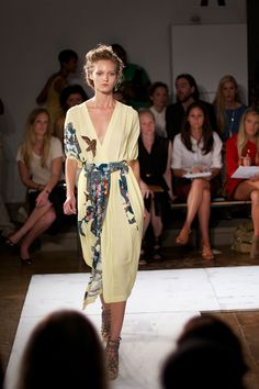 spring 2012, from the runway of suno.  beautiful pale yellow dress with flowers and birds aplenty.  photo snapped by erin hagstrom from the blog calivintage.