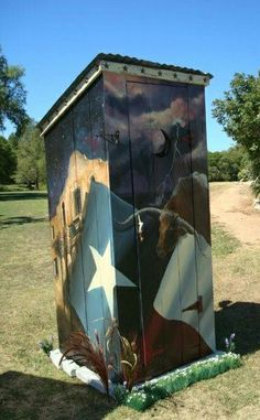 a Texas out house painted up pretty