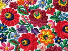 Vintage Hungarian Matyo Embroidered Centerpiece via kevintagtextiles.  Anita gave me this many years ago.