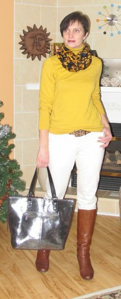 Mustard yellow sweater, white jeans, cognac boots, black bag.