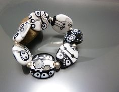 Monochrome lampwork beads stretch bracelet with by melaniemoertel, $150.00