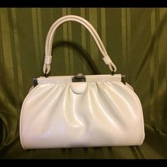 Vintage handbag Beautiful White Vintage Handbag. Great condition with signs of normal use. Great for 'All White' Events Vintage Bags