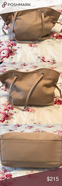Tory Burch Marion Slouchy Tote Still in pretty good condition. A mark on the front of the bag as pictured. Inside zip pocket is broken and cannot be closed. Inside is quite clean. Tory Burch Bags Totes