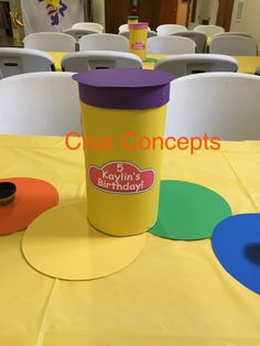 Table centerpiece decor table runner playdoh container with birthday girl name and number label.  Playdoh theme 5th birthday party decor decoration red yellow white rainbow circles dough game activity banner wall balloons container