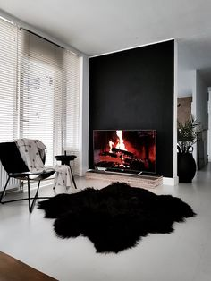vosgesparis: Ultra Black is the new Black | Philips 4k OLED Television #PhilipsTV #philips #philipstelevision #oled #LooksBetter #myhome #sheepskin #vitra #chair #fireplace