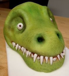 "T-Rex Cake Tutorial - Great tips on sculpting, recipe to make a store bought cake mix denser, cake ""clay"" marshmallow fondant . . ."