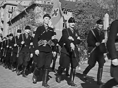 Arrow Cross Party members parade in the streets of Budapest